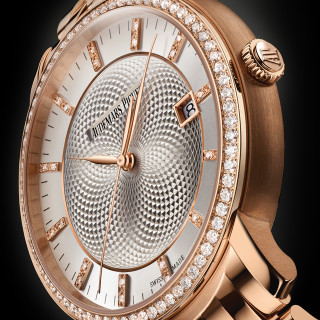 The silvery dial fake watch is decorated with diamonds.